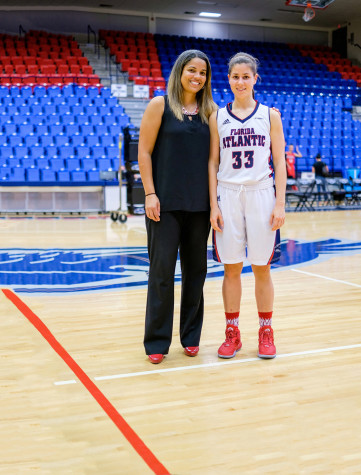 Women's basketball head coach Kellie Lewis-Jay (left) and sophomore guard Nika Zyryanova (right) pose for a photo after a 79-64 win against Barry University. Mohammed F. Emran | Asst. Creative Director