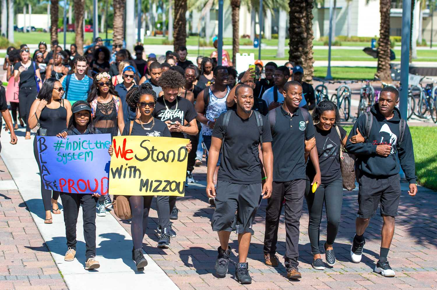 Approximately 60 students, dressed in all black started a march outside of the campus Recreation Center to show support for black students at the University of Missouri. Max Jackson  Staff Photographer