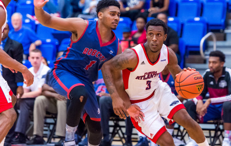 Owls guard Adonis Filer (3) dribbles around Bobcats defender Armand Shoon (1) in the first half of play on Nov. 5 versus St. Thomas. Max Jackson | Staff  Photographer