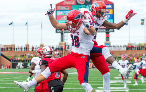 FAU wide receivers Jenson Stoshak (88) and Kalib Woods (81) celebrate after Stoshak scores the first touchdown of the game on a 19-yard pass from Jaquez Johnson (32).  Stoshak had four receptions for a total of 101 yards on the day. Max Jackson | Staff Photographer