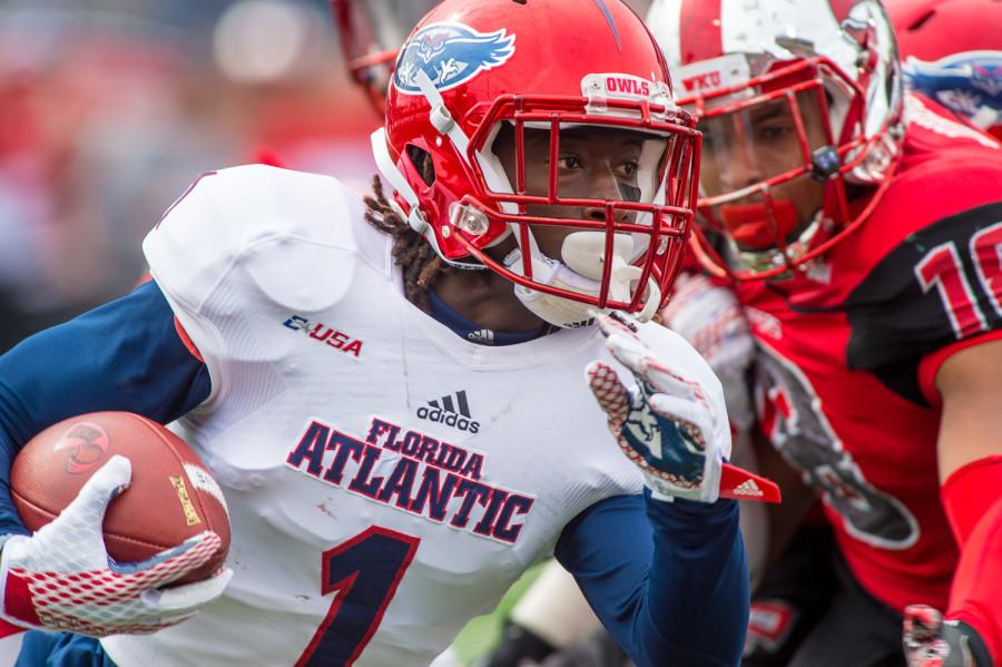 FAU wide receiver Henry Bussey (1) runs back a kickoff for 13 yards to the FAU 20. The ensuing drive started from the FAU 35 because of a WKU unsportsmanlike conduct penalty.  Max Jackson | Staff Photographer