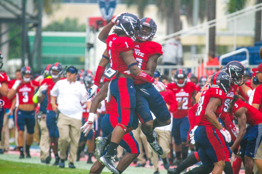 FAU defensive backs Ocie Rose (1) and Andrew Soroh (27) celebrate after Rose recovered a fumble in the first quarter of last week's 24-17 loss to Middle Tennessee. Josh Talero | Contributing Photographer