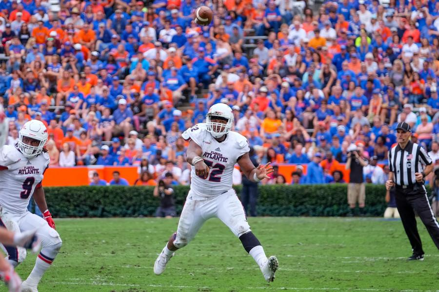 Redshirt+senior+quarterback+Jaquez+Johnson+%2832%29+throws+to+senior+wide+receiver+Jenson+Stoshak+%2888%29.+Johnson+had+148+yards+passing+against+the+University+of+Florida+on+Nov.+21.+Mohammed+Emran+%7C+Asst.+Creative+Director