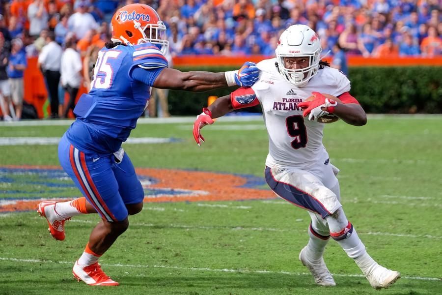 Owls%E2%80%99+sophomore+running+back+Greg+%E2%80%9CBuddy%E2%80%9D+Howell+%289%29+rushes+up+the+middle+for+9+yards+while+avoiding+a+Gator+defender.+Mohammed+F+Emran+%7C+Asst.+Creative+Director