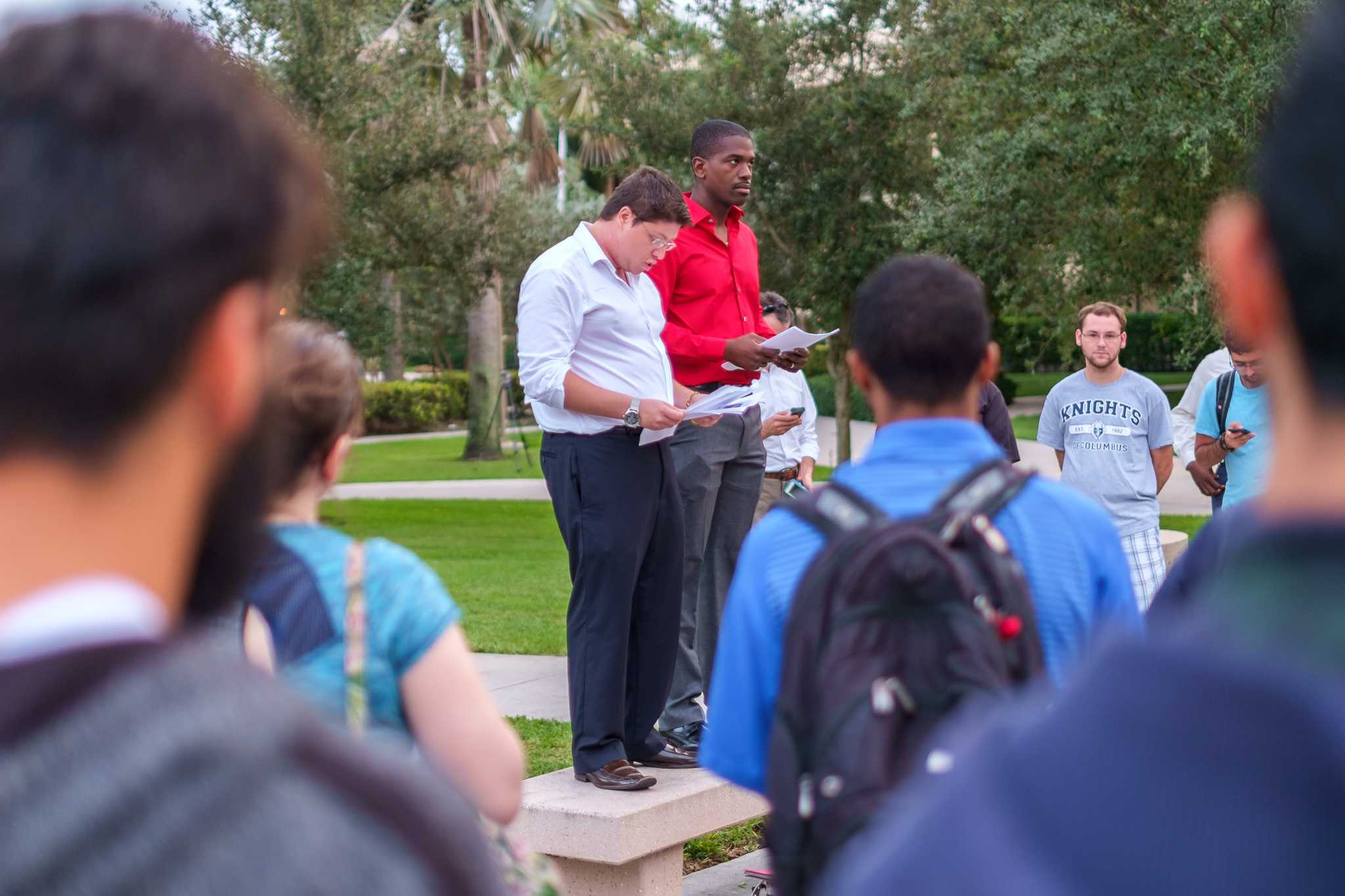 Zachary Pastor (left), senior studying pre­law criminal justice, gives a speech in front of 50 attendance during the Nov. 16 vigil for Paris. | Mohammed F Emran, Asst. Creative Director