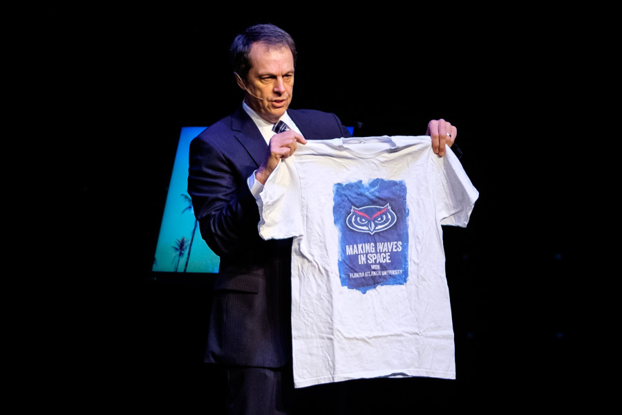 President John Kelly holds up a shirt that FAU alumnus and astronaut Steve Swanson wore on the International Space Station. Photo by Mohammed Emran | Assistant Creative Director