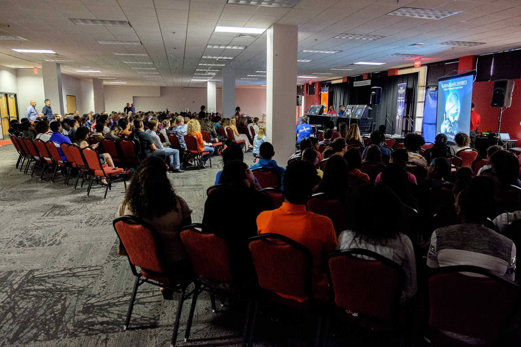 About 250 people attend American Astronaut Steven R. Swanson's presentation on his journey to and from the International Space Station on Oct. 30. Mohammed F Emran | Asst. Creative Director