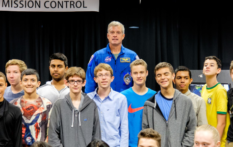 Astronaut Steven R. Swanson pose for a photo with students from different high schools. Mohammed F Emran | Asst. Creative Director