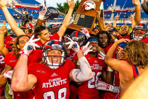 Members of the FAU football team celebrate after their 31-17 win over Florida International on Oct. 31. Photo by Max Jackson   Staff Photographer