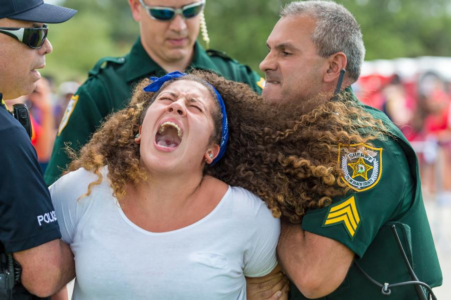 A+girl+is+forcibly+removed+from+the+FAU+versus+the+University+of+Miami+football+game+on+Sept.+11%2C+2015.+The+%0Astudy+on+police+body+cameras+found+that+nearly+50+percent+of+law+enforcement+officers+polled+%0Athink+cameras+will+impact+police+officers%E2%80%99+decisions+to+use+force.+Photo+by+Max+Jackson+%7C+Staff+Photographer