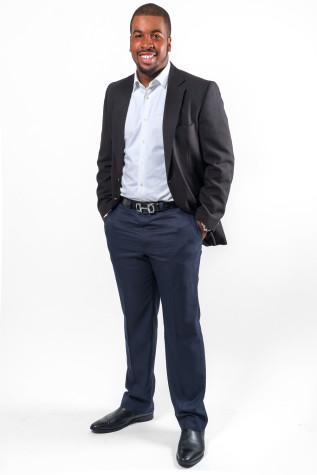 Johnson wears a George Sherman jacket, Nordstrom Rack button down, Ralph Lauren pants, an Hermes belt and Aldo shoes. Photo by Mohammed F. Emran   Asst. Creative Director