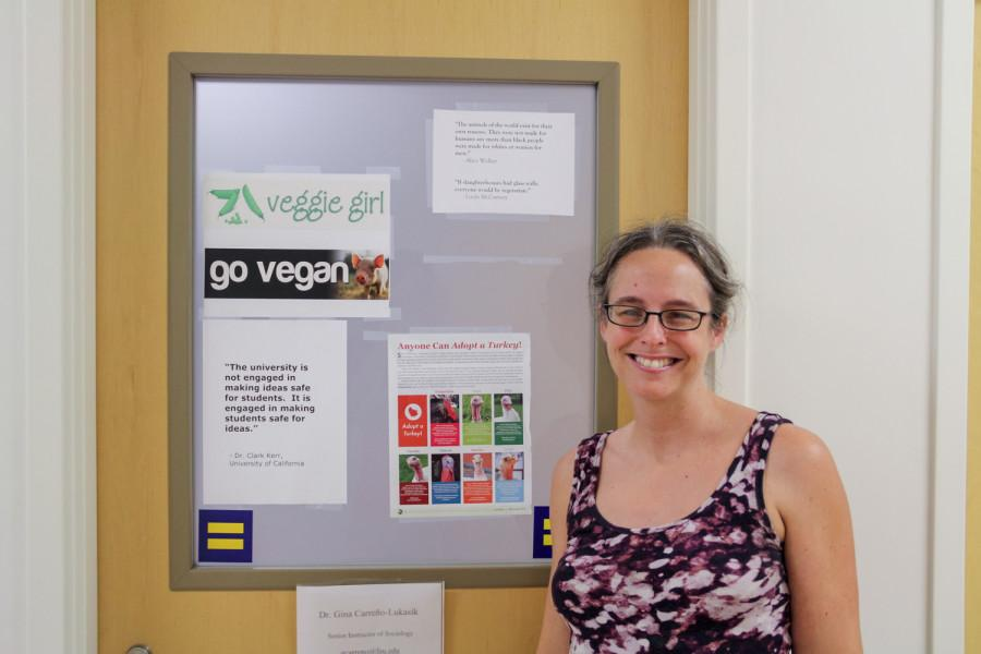 Proud vegetarian, Gina Carreno-Lukasik stands in front of her office door.   Photo By Andrew Fraieli | Science Editor