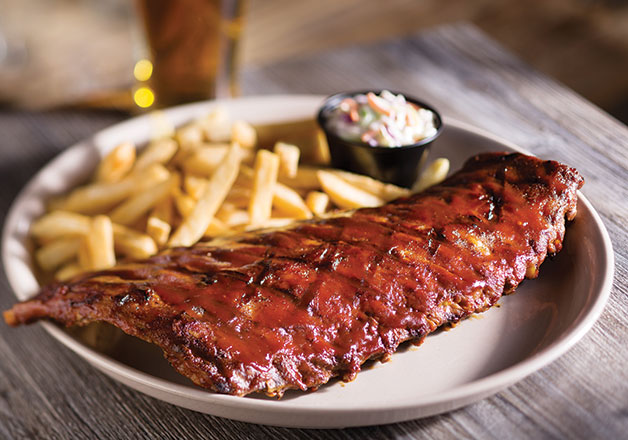 Baby back ribs are one of Miller's Ale House's house favorites. Slow cooked with the restaurant's secret recipe, these ribs are covered in Southern barbecue sauce with coleslaw and a side. Photo courtesy of Miller's Ale House's website.