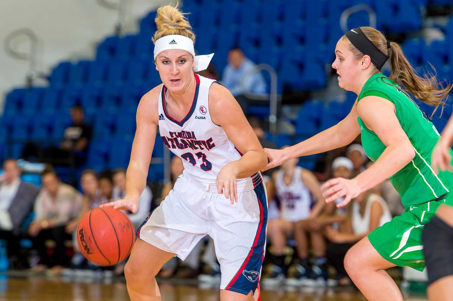 Redshirt senior Ali Gorrell dribbles towards the basket during the Owls' 84-73 victory over Marshall. Max Jackson | Staff Photographer