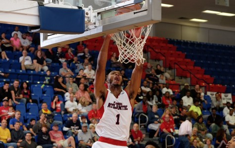 Freshman forward Jeantal Cylla dunks during the Owls' 63-61 comeback victory over Louisiana Tech. The win marks the first time under Michael Curry that the Owls have won back-to -back conference games. Mohammed Emran | Staff Photographer