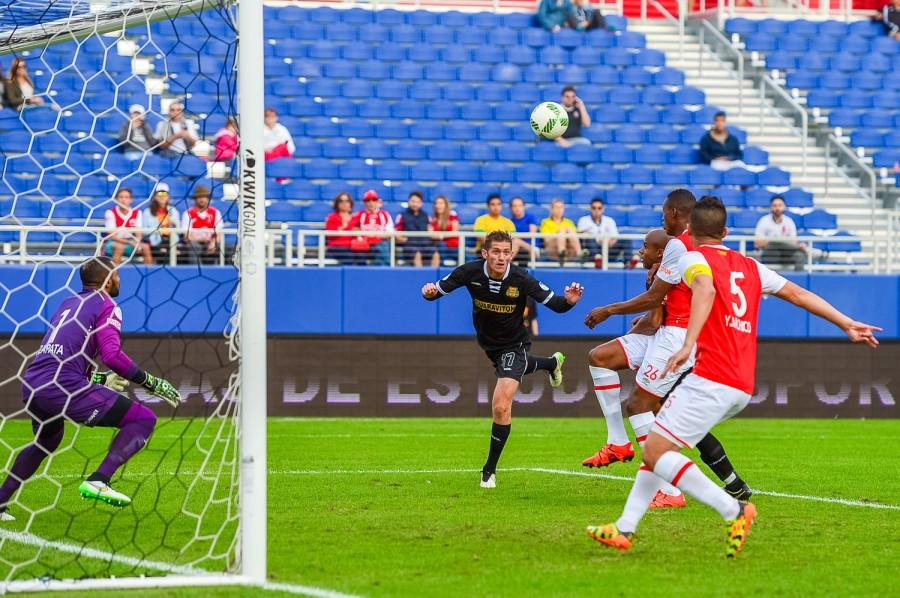 Andre Skiadas takes a header towards goal during the Fort Lauderdale Strikers 2-1 loss to Independiente Santa Fe. Max Jackson | Staff Photographer
