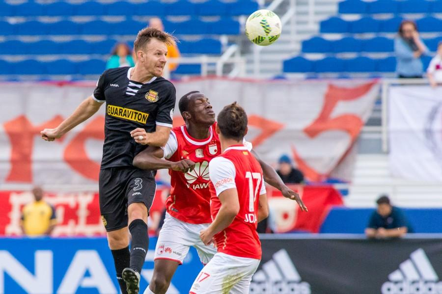 Neil Hlavety of the Strikers goes for a header during the second game of the Florida Cup. Max Jackson | Staff Photographer