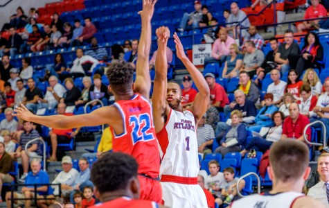 Owls' freshman forward Jeantal Cylla (1) shoots a 3­-pointer over Louisiana Tech's Jy'lan Washington (22) on Jan. 16. Mohammed Emran | Staff Photographer