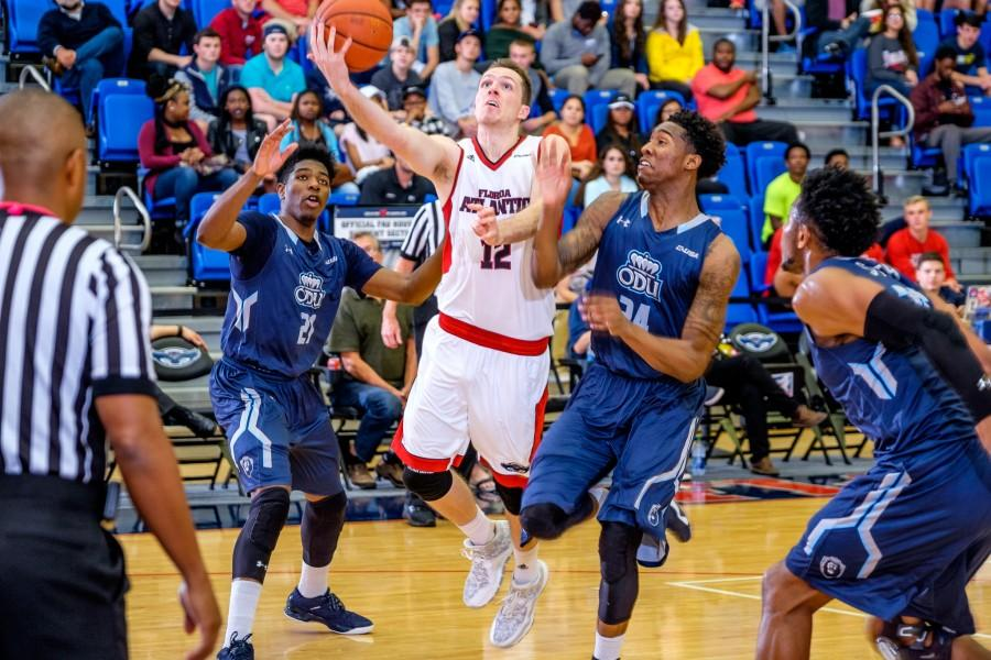 FAU guard Jackson Trapp dribbles past two Old Dominion defenders during the Owls' 78-66 loss against the Monarchs on Jan. 28. Mohammed F. Emran | Staff Photographer