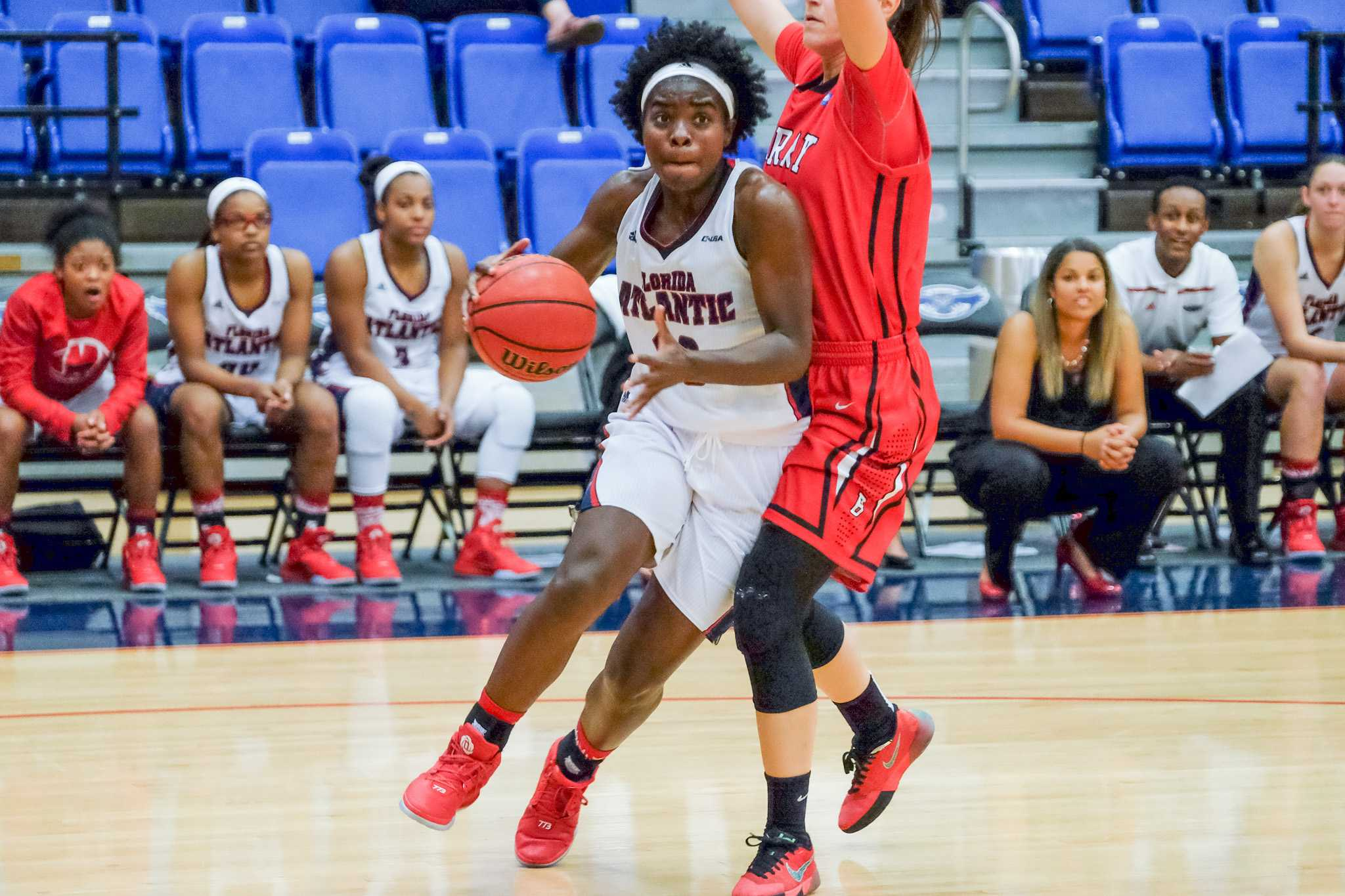 Senior guard Morgan Robinson (10) dribbles around Barry's Amra Elezovic (35) during the Owls' 79-64 exhibition win over Barry on Nov. 7. Mohammed Emran  | Staff Photographer