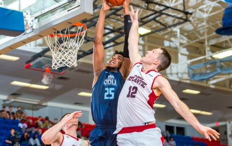 ODU forward Brandan Stith (25) and FAU guard Jackson Trapp (12) fight for a rebound early in the second half of the Owls' 78-66 loss on Jan 28. Max Jackson   Staff Photographer