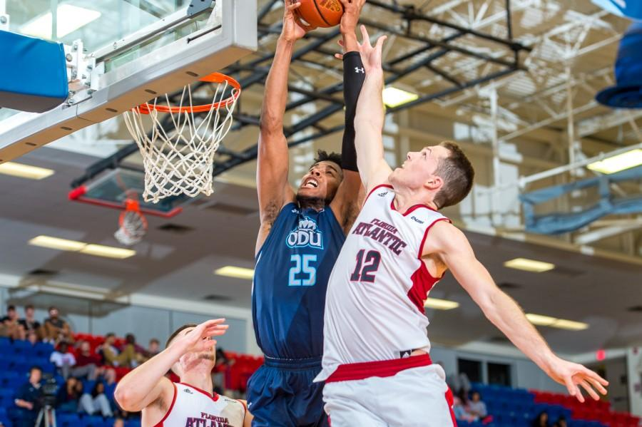 ODU forward Brandan Stith (25) and FAU guard Jackson Trapp (12) fight for a rebound early in the second half of the Owls 78-66 loss on Jan 28. Max Jackson   Staff Photographer