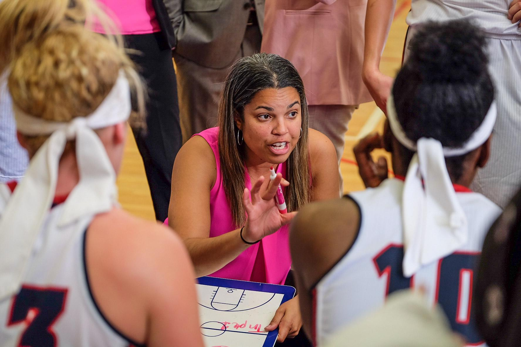 Head coach Kellie Lewis-Jay speaks to her players during her team's Feb. 18, 2016 loss to Rice.  PhotoMohammed F. Emran