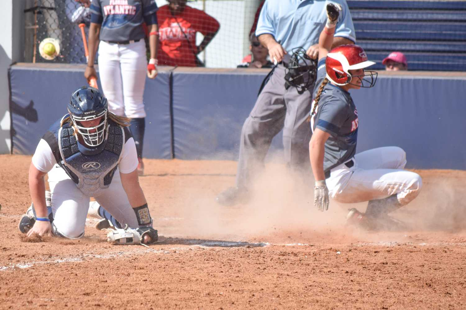 Senior outfielder Christina Martinez comes in to score as the Owls' second run of the game in the bottom of the third to give them a 2-0 lead. Ryan Lynch | Multimedia Editor