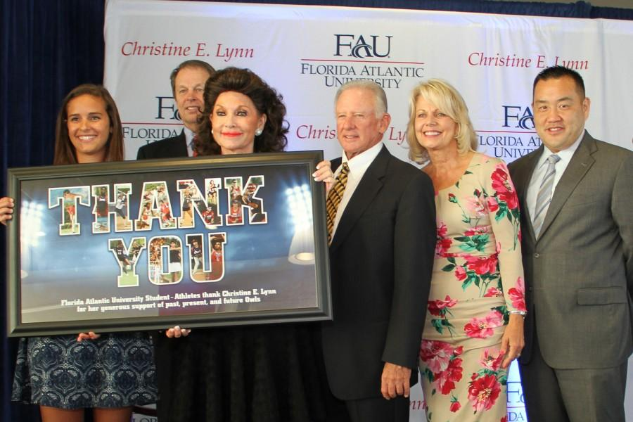 (L to R) Junior beach volleyball player Beth Shoaff, University President John Kelly, Christine E. Lynn, Dick Schmidt, Barbara Schmidt and Head Athletic Director Patrick Chun  stand with a gift from athletics thanking Lynn for her $5 million donation. Chun, who previously worked at Ohio State, was a finalist for the athletic director job at Illinois. Ryan Lynch   Multimedia Editor
