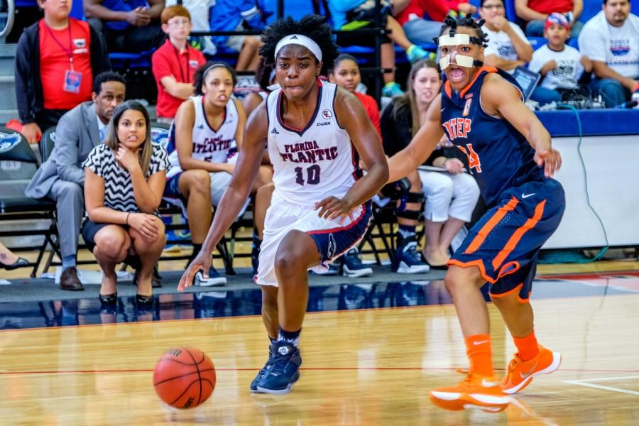 Senior guard Morgan Robinson (10) dribbles past a UTEP defender for a layup during FAU's 78-66 loss to the Miners on Jan. 21. Mohammed F. Emran | Staff Photographer