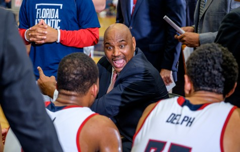 Head coach Michael Curry talks to his team during the Owls' 89-82 loss to UTEP on Feb. 13. Mohammed F Emran | Staff Photographer