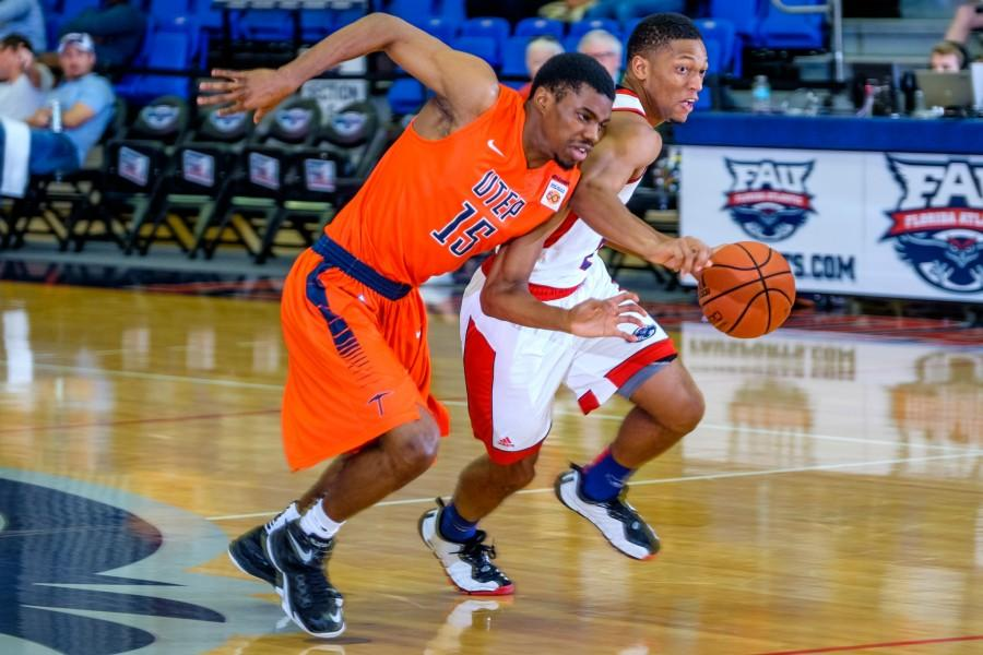 Owls junior guard Marquan Botley (2) tries to pass Miners defender Tevin Caldwell (15) during FAU's 89-82 loss to UTEP last Saturday. Mohammed F. Emran | Staff Photographer