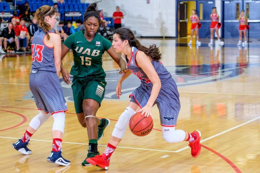 Owls' guard Nika Zyryanova (33) sets up a pick while teammate Kat Wright (13) dribbles past a UAB defender during the Owls' 67-62 loss to the Blazers on Feb. 6. Mohammed F. Emran | Staff Photographer