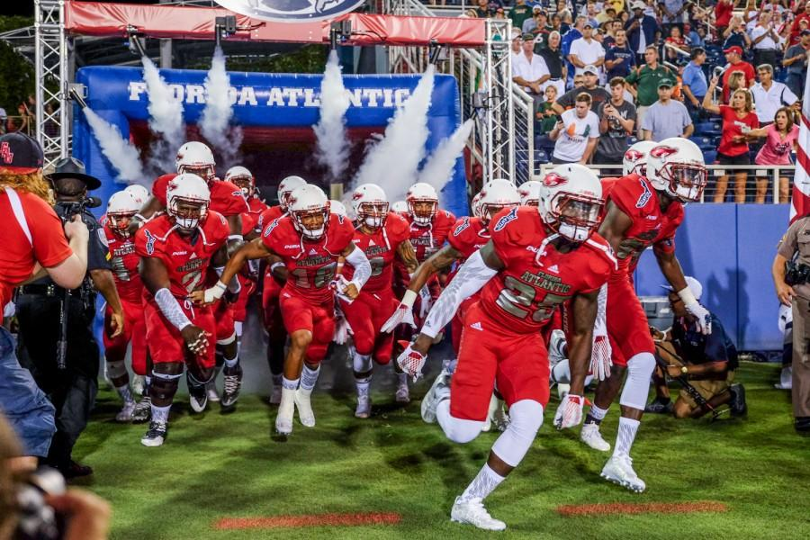 Florida Atlantic Football players enter the field before their game on Sept. 11, 2015 versus the University of Miami Hurricanes. Mohammed F. Emran | Staff Photographer