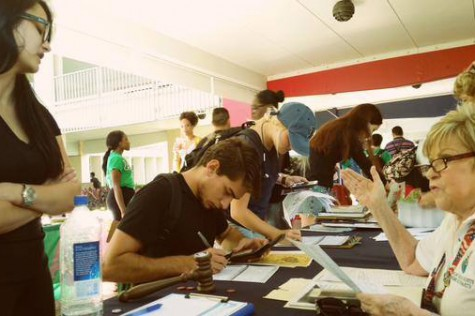 The club strives to help students get more involved with politics by helping them register to vote in the Breezeway. Photo courtesy of FAU College Democrats' Owl Central page.