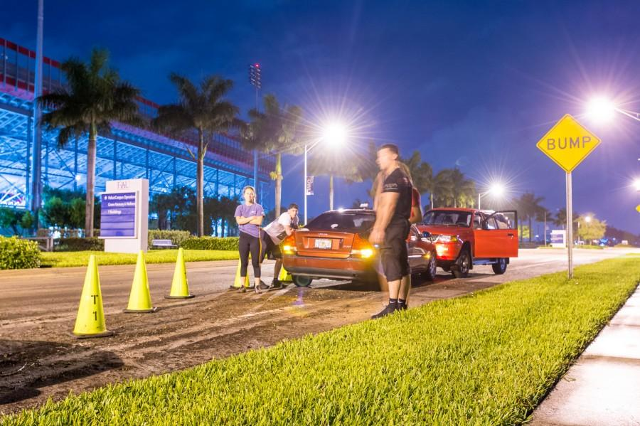 Nick Peragine, an exercise science student at FAU, stands by his stranded Volvo after trying to leave campus on Thursday evening. Max Jackson   Staff Photographer