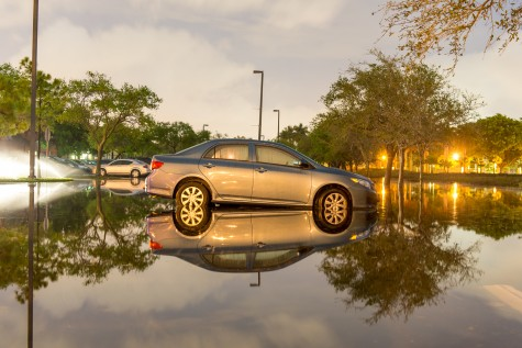 A Toyota Camry sits in over 6 inches of water behind University Village Apartments early Friday morning after Thursday evening's downpour flooded the area. Max Jackson | Staff Photographer
