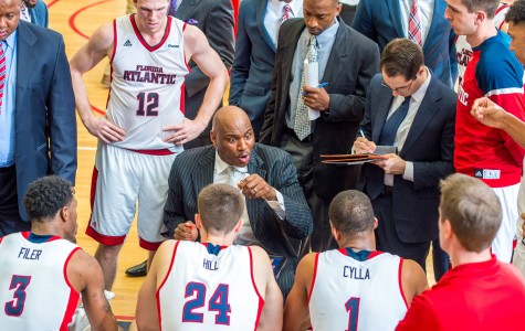 FAU head coach Michael Curry talks to his team during a media timeout late in the second half of his team's 76-59 loss to Middle Tennessee on March 3. Max Jackson | Staff Photographer