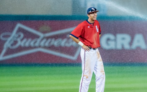 Shortstop CJ Chatham (10) laughs as the sprinklers come on by accident during the sixth inning of FAU's 10-8 loss to the Florida Gators on Feb. 24, 2015. Max Jackson | Staff Photographer