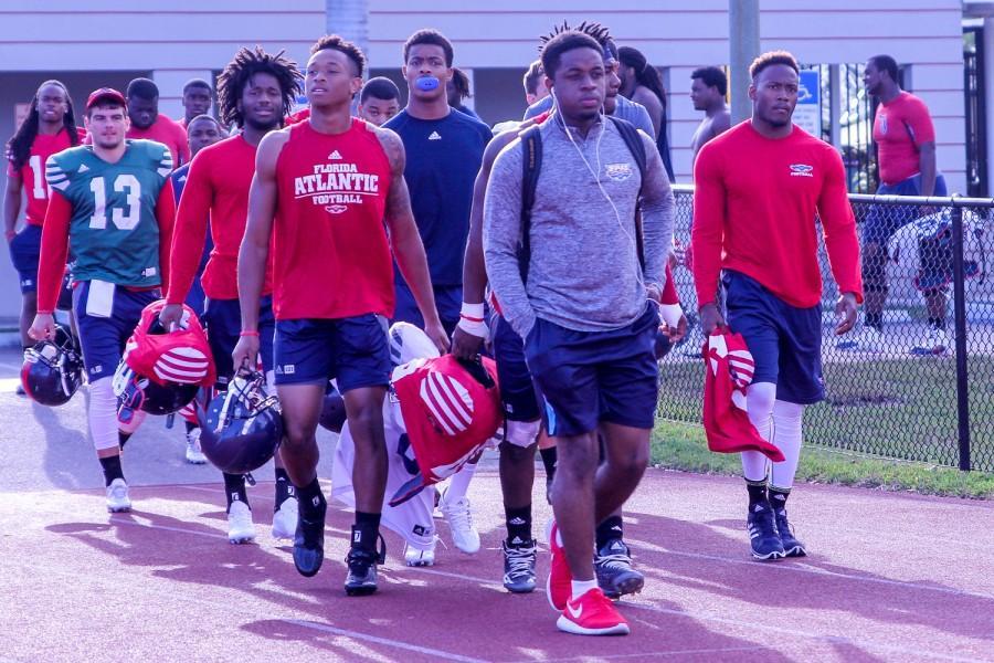 Florida Atlantic football players walk onto the field for practice in Broward Tuesday morning. Brendan Feeney | Sports Editor
