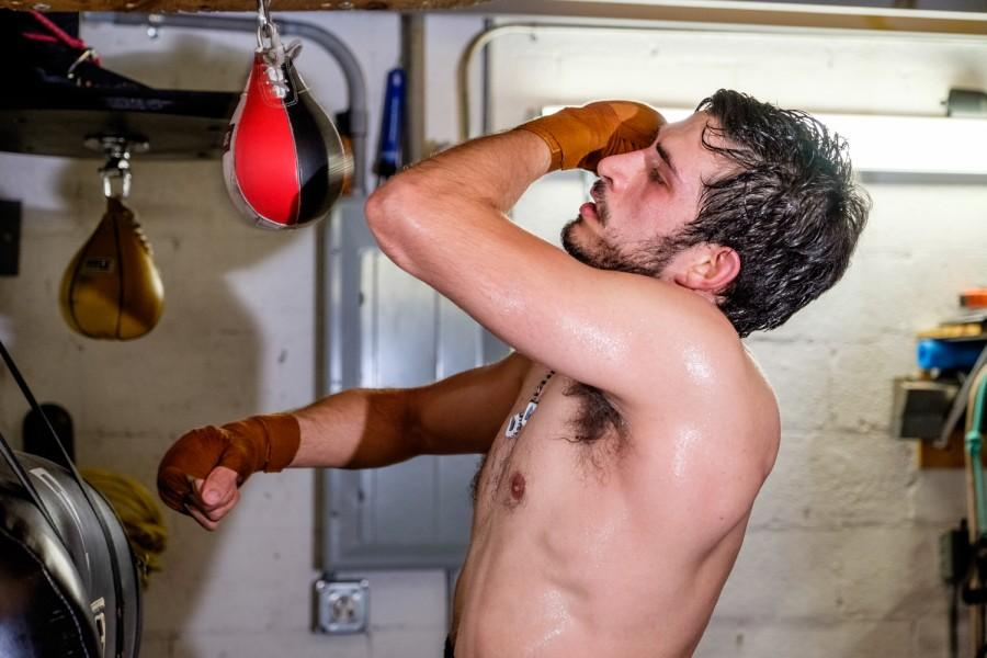 Diaz Mateus practices his punching on a speedbag. Mohammed F. Emran |Staff Photographer