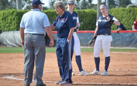 Head softball coach Joan Joyce talks to an umpire about a collision that had happened between second and third base during the Owls' game versus Penn State on Feb. 14.  Ryan Lynch | Multimedia Editor