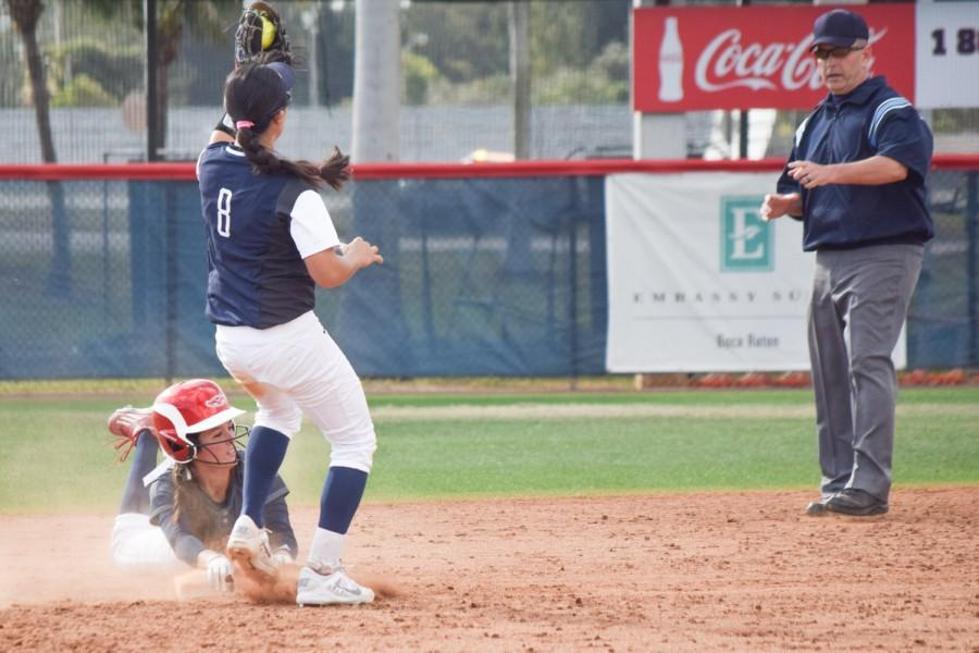 Sophomore Delaney Rickey is tagged out at second base during the Owls 4-2 win over Penn State on Feb. 14. Ryan Lynch | Multimedia Editor