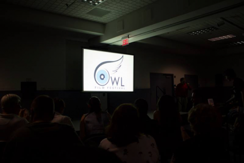 An audience at the fifth annual Owl Film Festival watching the screen. Photo courtesy of Owl Film Club's Facebook page.
