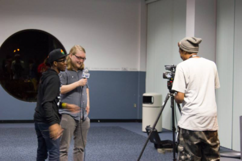 Students filming at the 5th annual Owl Film Festival. Photo courtesy of Owl Film Club's Facebook page.