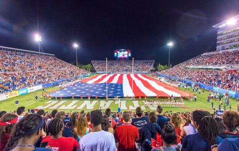 A large flag is stretched across the field before the Owls' game versus Miami on Sept. 11, 2015. Max Jackson | Staff Photographer