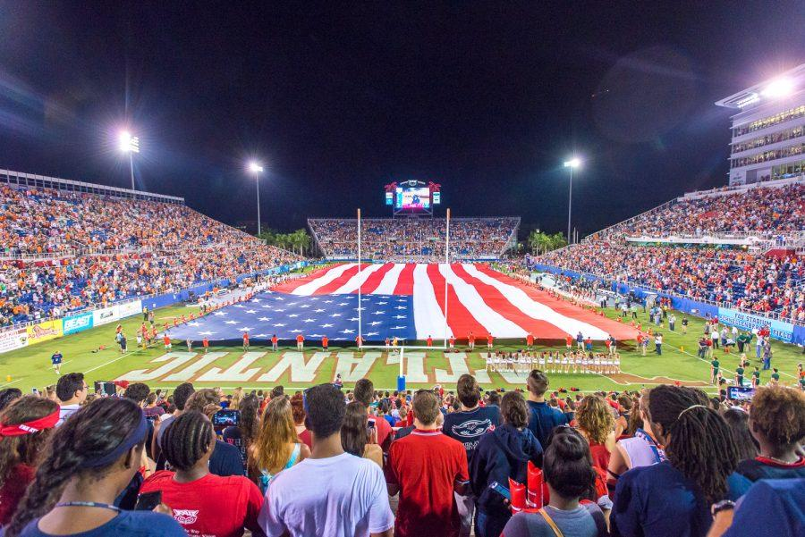 A+large+flag+is+stretched+across+the+field+before+the+Owls%27+game+versus+Miami+on+Sept.+11%2C+2015.+Max+Jackson+%7C+Staff+Photographer