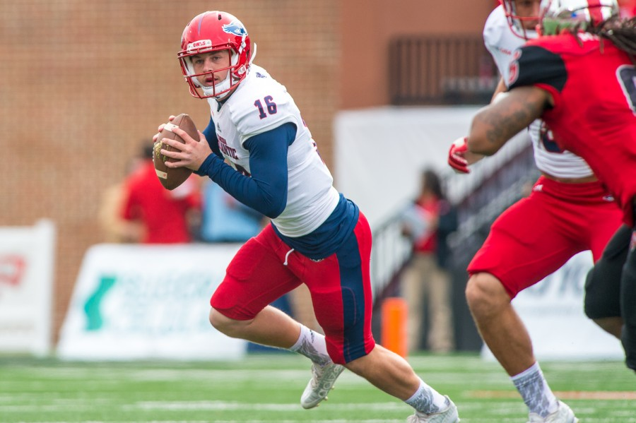 Jason Driskel looks for an open receiver while scrambling out of the pocket against Western Kentucky University in a game last season. Max Jackson | Staff Photographer