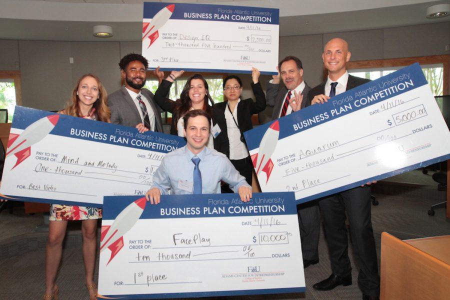 Senior business administration and marketing double major David Parshnekov and other winners take home their monetary prizes. Photo courtesy of David Parshnekov.
