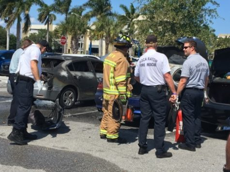 Boca Raton Fire Rescue arrived on the scene shortly after the car caught fire. Photo by Joe Pye | Staff Reporter